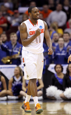 CLEVELAND, OH - MARCH 18: Scoop Jardine #11 of the Syracuse Orange pumps his fist during the second half against the Indiana State Sycamores during the second round of the 2011 NCAA men's basketball tournament at Quicken Loans Arena on March 18, 2011 in C