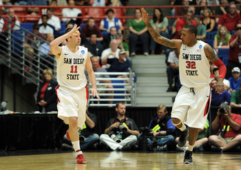TUCSON, AZ - MARCH 17:  James Rahon #11 of the San Diego State Aztecs celebrates sinking a three-pointer with teammate Billy White #32 against the Northern Colorado Bears during the second round of the 2011 NCAA men's basketball tournament at McKale Cente
