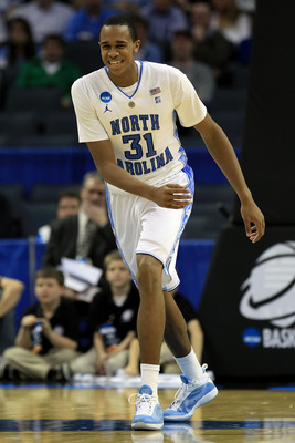 CHARLOTTE, NC - MARCH 18:  John Henson #31 of the North Carolina Tar Heels reacts in the second half while taking on the Long Island Blackbirds during the second round of the 2011 NCAA men's basketball tournament at Time Warner Cable Arena on March 18, 20