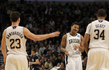 CHICAGO, IL - MARCH 18:  Ben Hansbrough, Tyrone Nash #1 and Carleton Scott #34 of the Notre Dame Fighting Irish celebrate their 69-56 win over the Akron Zips during the second round of the 2011 NCAA men's basketball tournament at the United Center on Marc