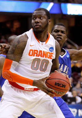 CLEVELAND, OH - MARCH 18: Rick Jackson #00 of the Syracuse Orange handles the ball against Myles Walker #34 of the Indiana State Sycamores during the second round of the 2011 NCAA men's basketball tournament at Quicken Loans Arena on March 18, 2011 in Cle