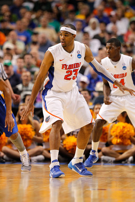 TAMPA, FL - MARCH 17:  Alex Tyus #23 of the Florida Gators defends against the UC Santa Barbara Gauchos during the second round of the 2011 NCAA men's basketball tournament at St. Pete Times Forum on March 17, 2011 in Tampa, Florida. Florida won 79-51.  (