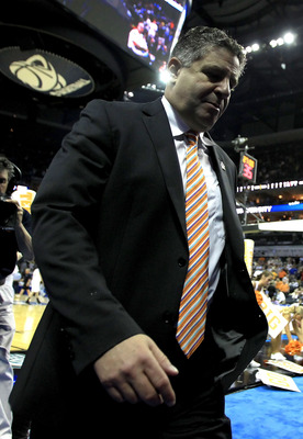 CHARLOTTE, NC - MARCH 18:  Head coach Bruce Pearl of the Tennessee Volunteers walks off the court after the Volunteers were defeated 75-45 by the Michigan Wolverines during the second round of the 2011 NCAA men's basketball tournament at Time Warner Cable