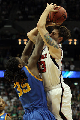 DENVER, CO - MARCH 17:  Kenneth Faried #35 of the Morehead State Eagles blocks the shot of Mike Marra #33 of the Louisville Cardinals with time running out in the second half during the second round of the 2011 NCAA men's basketball tournament at Pepsi Ce