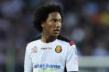 BARCELONA, SPAIN - OCTOBER 03:  Jonathan De Guzman of Mallorca looks on during the La Liga match between Barcelona and Mallorca at the Camp Nou stadium on October 3, 2010 in Barcelona, Spain. The Match ended in a 1-1 draw. (Photo by David Ramos/Getty Imag