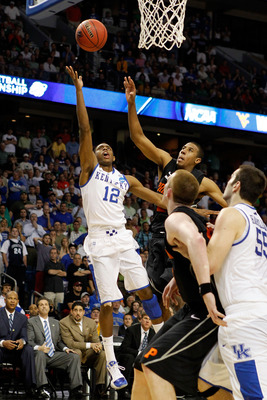TAMPA, FL - MARCH 17:  Brandon Knight #12 of the Kentucky Wildcats makes the go ahead basket to give Kentucky a 59-57 lead late in the fourth quarter against the Princeton Tigers during the second round of the 2011 NCAA men's basketball tournament at St.
