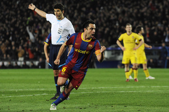 BARCELONA, SPAIN - MARCH 08:  Xavi Hernandez of FC Barcelona (C) celebrates after scoring his team's second goal during the UEFA Champions League round of 16 second leg match between Barcelona and Arsenal at the Camp Nou stadium on March 8, 2011 in Barcel