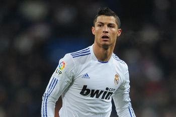 MADRID, SPAIN - MARCH 03:  Cristiano Ronaldo of Real Madrid looks on during the la Liga match between Real Madrid and Malaga at Estadio Santiago Bernabeu on March 3, 2011 in Madrid, Spain.  (Photo by Jasper Juinen/Getty Images)
