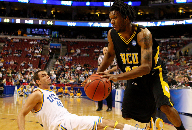 PHILADELPHIA - MARCH 19:  T.J. Gwynn #42 of the VCU Rams drives past Nikola Dragovic #41 of the UCLA Bruins during the first round of the NCAA Division I Men's Basketball Tournament at the Wachovia Center on March 19, 2009 in Philadelphia, Pennsylvania.