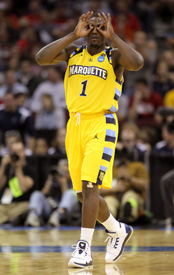 CLEVELAND, OH - MARCH 18:  Darius Johnson-Odom #1 of the Marquette Golden Eagles gestures after making a three point basket against the Xavier Musketeers during the second round of the 2011 NCAA men's basketball tournament at Quicken Loans Arena on March