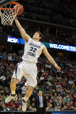DENVER, CO - MARCH 17:  Jimmer Fredette #32 of the Brigham Young Cougars goes up for a layup against the Wofford Terriers during the second round of the 2011 NCAA men's basketball tournament at Pepsi Center on March 17, 2011 in Denver, Colorado.  (Photo b
