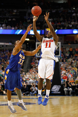 TAMPA, FL - MARCH 17:  Erving Walker #11 of the Florida Gators attempts a shot against Orlando Johnson #33 of the UC Santa Barbara Gauchos  sduring the second round of the 2011 NCAA men's basketball tournament at St. Pete Times Forum on March 17, 2011 in