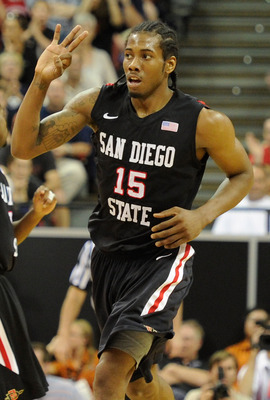 LAS VEGAS, NV - MARCH 12:  Kawhi Leonard #15 of the San Diego State Aztecs holds up three fingers after scoring a three-point basket against the Brigham Young University Cougars during the championship game of the Conoco Mountain West Conference Basketbal