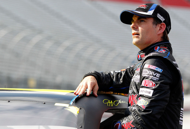 BRISTOL, TN - MARCH 18: Jeff Gordon, driver of the #24 Pepsi MAX Chevrolet, climbs from his car after qualifying for the NASCAR Sprint Cup Series Jeff Byrd 500 Presented By Food City at Bristol Motor Speedway on March 18, 2011 in Bristol, Tennessee.  (Pho