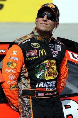 BRISTOL, TN - MARCH 18:  Jamie McMurray, driver of the #1 Bass Pro Shops/Tracker Chevrolet, stands on the grid during qualifying for the NASCAR Sprint Cup Series Jeff Byrd 500 Presented By Food City at Bristol Motor Speedway on March 18, 2011 in Bristol, 
