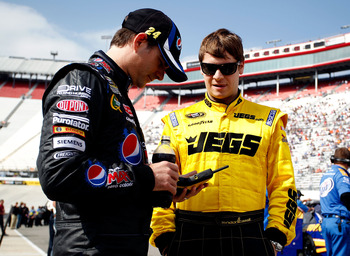 BRISTOL, TN - MARCH 18:  Landon Cassill (R), driver of the #60 Big Red Toyota, talks with Jeff Gordon (L), driver of the #24 Pepsi Max Chevrolet, during qualifying for the NASCAR Sprint Cup Series Jeff Byrd 500 Presented By Food City at Bristol Motor Spee