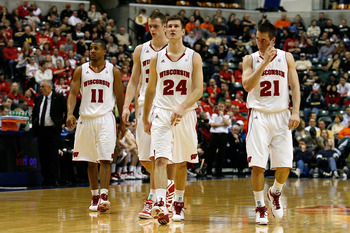 INDIANAPOLIS, IN - MARCH 11:  (L-R) Jordan Taylor #11, Jon Leuer #30, Tim Jarmusz #24 and Josh Gasser #21 of the Wisconsin Badgers walk up court against the Penn State Nittany Lions during the quarterfinals of the 2011 Big Ten Men's Basketball Tournament