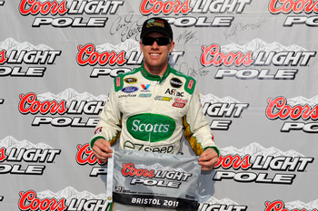 BRISTOL, TN - MARCH 18:  Carl Edwards, driver of the #99 Scotts' Ford, poses in Victory Lane after qualifying for pole position in the NASCAR Sprint Cup Series Jeff Byrd 500 Presented By Food City at Bristol Motor Speedway on March 18, 2011 in Bristol, Te