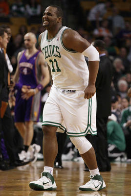 BOSTON, MA - MARCH 02:  Glen Davis #11 of the Boston Celtics winces in pain as he walks off the court in the fourth quarter against the Phoenix Suns on March 2, 2011 at the TD Garden in Boston, Massachusetts.  The Celtics defeated the Suns 115-103. NOTE T