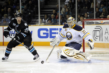 SAN JOSE, CA - JANUARY 6:  Goalie Ryan Miller #30 of the Buffalo Sabres makes a save in front of Logan Couture #39 of the San Jose Sharks during an NHL hockey game at the HP Pavilion on January 6, 2011 in San Jose, California. (Photo by Thearon W. Henders