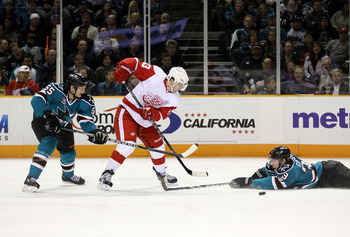 SAN JOSE, CA - NOVEMBER 30:  Logan Couture #39 of the San Jose Sharks dives to try to stop Pavel Datsyuk #13 of the Detroit Red Wings at HP Pavilion on November 30, 2010 in San Jose, California.  (Photo by Ezra Shaw/Getty Images)