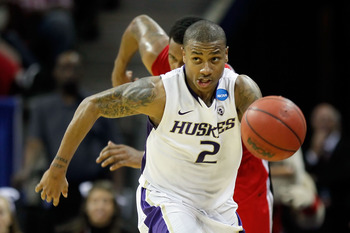 CHARLOTTE, NC - MARCH 18:  Isaiah Thomas #2 of the Washington Huskies moves the ball upcourt while taking on the Georgia Bulldogs during the second round of the 2011 NCAA men's basketball tournament at Time Warner Cable Arena on March 18, 2011 in Charlott