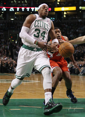 BOSTON, MA - MARCH 09:  Paul Pierce #34 of the Boston Celtics has the ball knocked away by Ryan Gomes #15 of the Los Angeles Clippers on March 9, 2011 at the TD Garden in Boston, Massachusetts. NOTE TO USER: User expressly acknowledges and agrees that, by