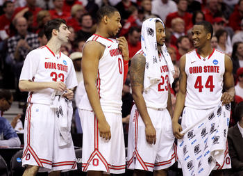 CLEVELAND, OH - MARCH 18: Jon Diebler #33, Jared Sullinger #0, David Lighty #23 and William Buford #44 of the Ohio State Buckeyes look on from the bench late in the second half against the Texas-San Antonio Roadrunners during the second round of the 2011