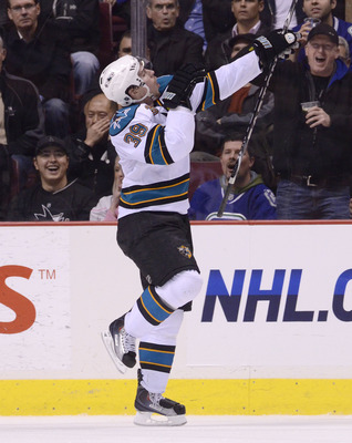 VANCOUVER, CANADA - JANUARY 20: Logan Couture #39 of the San Jose Sharks celebrates after scoring against the Vancouver Canucks during the second period in NHL action on January 20, 2011 at Rogers Arena in Vancouver, BC, Canada.  (Photo by Rich Lam/Getty