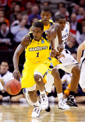 CLEVELAND, OH - MARCH 18: Darius Johnson-Odom #1 of the Marquette Golden Eagles brings the ball up court against the Xavier Musketeers during the second round of the 2011 NCAA men's basketball tournament at Quicken Loans Arena on March 18, 2011 in Clevela