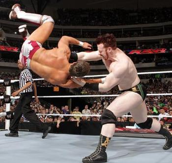 Sheamus throwing Bryan across the ring