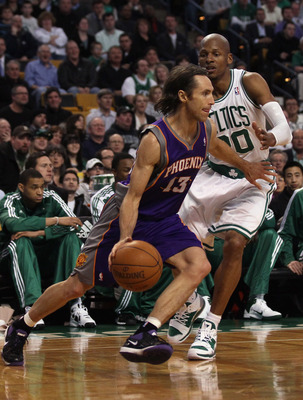 BOSTON, MA - MARCH 02:  Steve Nash #13 of the Phoenix Suns drives around Ray Allen #20 of the Boston Celtics on March 2, 2011 at the TD Garden in Boston, Massachusetts.  The Celtics defeated the Suns 115-103. NOTE TO USER: User expressly acknowledges and