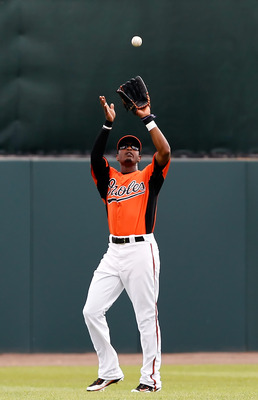 SARASOTA, FL - MARCH 05:  Outfielder Adam Jones #10 of the Baltimore Orioles catches a fly ball against the Boston Red Sox during a Grapefruit League Spring Training Game at Ed Smith Stadium on March 5, 2011 in Sarasota, Florida.  (Photo by J. Meric/Getty
