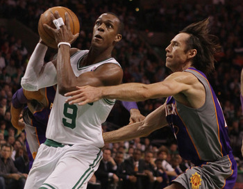 BOSTON, MA - MARCH 02:  Rajon Rondo #9 of the Boston Celtics heads for the net as Steve Nash #13 of the Phoenix Suns defends on March 2, 2011 at the TD Garden in Boston, Massachusetts.  NOTE TO USER: User expressly acknowledges and agrees that, by downloa