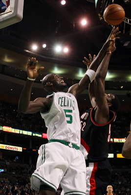 BOSTON - DECEMBER 05:  Kevin Garnett #5 of the Boston Celtics tries to block a shot from Greg Oden #52 of the Portland Trail Blazers on December 5, 2008 at TD Banknorth Garden in Boston, Massachusetts. The Celtics defeated the Trail Blazers 93-78.  NOTE T