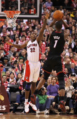 TORONTO, CAN - FEBRUARY 16:  Chris Bosh #1 of the Miami Heat shoots against  Ed Davis #32 of the Toronto Raptors in a game on February 16, 2011 at the Air Canada Centre in Toronto, Canada. The Heat defeated the Raptors 103-95. (Photo by Claus Andersen/Get