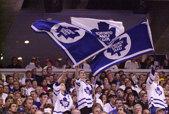 7 May 2001: Toronto Maple Leafs fans waves flags during game 6 of the Eastern Conference Semifinals against the New Jersey Devils at the Air Canada Center in Toronto, Ontario, Canada.  The Devils won 4-2. DIGITAL IMAGE.  Mandatory Credit: Harry How/ALLSPO