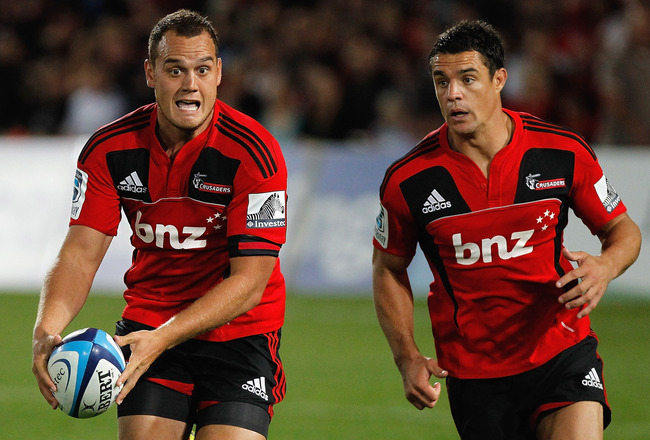 NELSON, NEW ZEALAND - MARCH 11:  Israel Dagg (L) of the Crusaders makes a break with team mate Dan Carter during the round four Super Rugby match between the Crusaders and the Brumbies at Trafalgar Park on March 11, 2011 in Nelson, New Zealand.  (Photo by