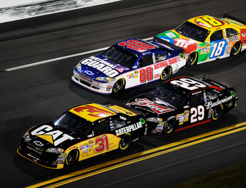 DAYTONA BEACH, FL - FEBRUARY 12:  Jeff Burton, driver of the #31 Caterpilliar Chevrolet, leads Kevin Harvick, driver of the #29 Budweiser Chevrolet, Dale Earnhardt Jr., driver of the #88 National Guard/AMP Energy Chevrolet, and Kyle Busch, driver of the #