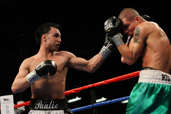 MASHANTUCKET, CT - APRIL 25:  Paulie Malignaggi lands a left Chris Fernandez during their bout at the MGM Grand at Foxwoods on April 25, 2009 in Mashantucket, Connecticut.  (Photo by Nick Laham/Getty Images)