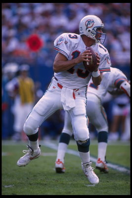 3 Dec 1995:  Quarterback Dan Marino #13 of the Miami Dolphins drops back to pass downfield against the Atlanta Falcons at Joe Robbie Stadium in Miami, Florida.  The Dolphins edged out the Falcons 21-20.  Mandatory Credit:  Scott Halleran/Allsport