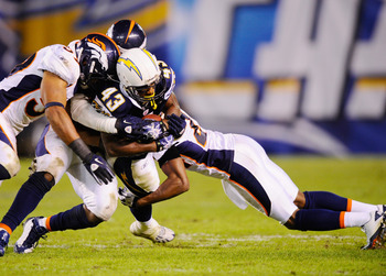 SAN DIEGO - NOVEMBER 22: Darren Sproles #43 of the San Diego Chargers is tackled by group of Denver Broncos defenders at Qualcomm Stadium on November 22, 2010 in San Diego, California.  Chargers defeated the Broncos, 35-14.  (Photo by Kevork Djansezian/Ge