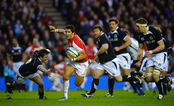 EDINBURGH, SCOTLAND - FEBRUARY 12:  James Hook of Wales beaks past Rory Lawson of Scotland during the RBS 6 Nations Championship match between Scotland and Wales at Murrayfield Stadium on February 12, 2011 in Edinburgh, Scotland.  (Photo by Laurence Griff