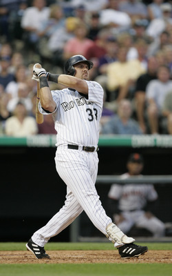 DENVER - JULY 17:  Right fielder Larry Walker #33 of the Colorado Rockies watches the flight of the ball as he follows through on a swing during the game against the San Francisco Giants at Coors Field on July 17, 2004 in Denver, Colorado.  The Giants won