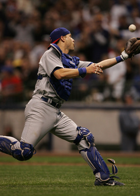 MILWAUKEE - JUNE 4: Michael Barrett #8 of the Chicago Cubs makes a catch of a ball hit by Corey Hart of the Milwaukee Brewers following a fielding error by the Cubs at Miller Park June 4, 2007 in Milwaukee, Wisconsin. (Photo by Jonathan Daniel/Getty Image