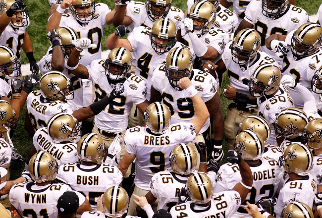 NEW ORLEANS - SEPTEMBER 09:  Drew Brees #9 of the New Orleans Saints leads his team in a chant as they huddle up prior to playing the Minnesota Vikings at Louisiana Superdome on September 9, 2010 in New Orleans, Louisiana.  (Photo by Chris Graythen/Getty