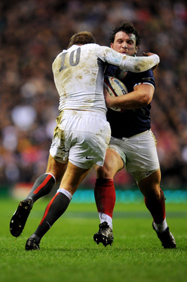 LONDON, ENGLAND - FEBRUARY 26:  Thomas Domingo of France is tackled by Toby Flood of England during the RBS 6 Nations Championship match between England and France at Twickenham Stadium on February 26, 2011 in London, England.  (Photo by Clive Mason/Getty
