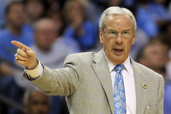 CHARLOTTE, NC - MARCH 18:  Head coach Roy Williams of the North Carolina Tar Heels points in the second half while taking on the Long Island Blackbirds during the second round of the 2011 NCAA men's basketball tournament at Time Warner Cable Arena on Marc