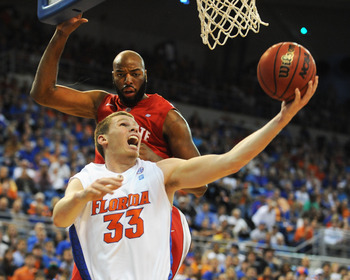 GAINESVILLE, FL - NOVEMBER 16: Erik Murphy #33 of the Florida Gators scores under the basket against Dallas Lauderdale #52 of Ohio State Buckeyes during the game on November 16, 2010 at the Stephen C. O'Connell Center in Gainesville, Florida.  (Photo by A