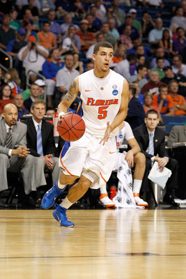 TAMPA, FL - MARCH 17:  Scottie Wilbekin #5 of the Florida Gators drives against the UC Santa Barbara Gauchos during the second round of the 2011 NCAA men's basketball tournament at St. Pete Times Forum on March 17, 2011 in Tampa, Florida. Florida won 79-5